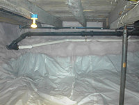 Crawlspace after the installation of vapor retarder and foam insulation