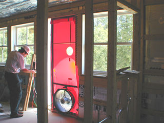 Technician conducting a blower door test